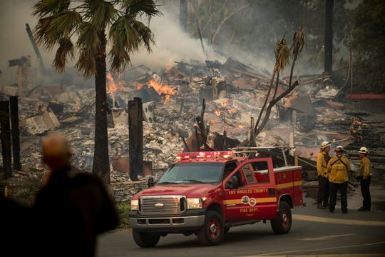 FILE - In this Dec. 5, 2017, file photo, an apartment complex burns as a wildfire rages in Ventura, Calif. California's massive property insurance market is feeling the effects of three straight years of damaging wildfires. Insurers have pulled out of some markets and canceled thousands of policies, forcing regulators to step in and expand a state program that homeowners often turn to as a last resort. (AP Photo/Noah Berger, File)