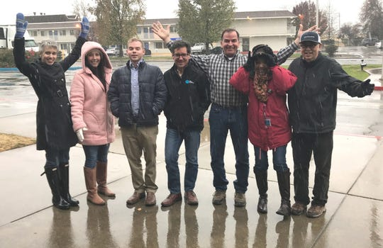 Record Searchlight journalists, from left to right, Jessica Skropanic, Alayna Shulman, Matt Brannon, David Benda, Damon Arthur, Michele Chandler and Mike Chapman pose during a hailstorm outside the newsroom on Nov. 26, 2019.