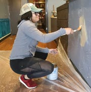 Redding YAKS co-owner Alyssa Williams paints inside the new restaurant that's due to open Jan. 1, 2020, off Hilltop Drive.