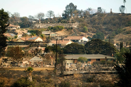 FILE - In this Dec. 6, 2017, file photo, homes scorched by a wildfire line a hillside in Ventura, Calif.  California's massive property insurance market is feeling the effects of three straight years of damaging wildfires. Insurers have pulled out of some markets and canceled thousands of policies, forcing regulators to step in and expand a state program that homeowners often turn to as a last resort. (AP Photo/Noah Berger, File)