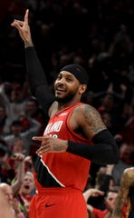 Portland Trail Blazers forward Carmelo Anthony reacts after hitting a shot during the first half of an NBA basketball game against the New Orleans Pelicans in Portland, Ore., Monday, Dec. 23, 2019.