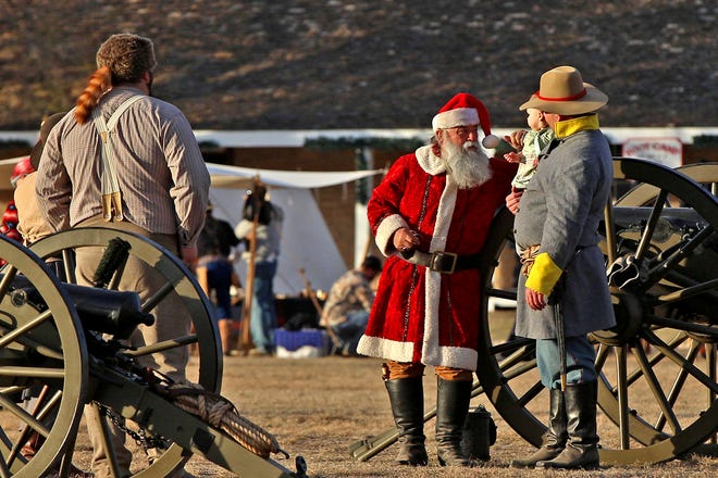 Santa Claus talks with some of the re-enactors at the Christmas at Old Fort Concho celebration Saturday, Dec. 7, 2019.