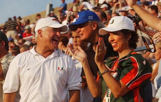 Rick Berlin and Nancy Berlin, the parents of then-Miami quarterback Brock Berlin, cheer for their son with Evangel pastor Denny Duron during a 2003 matchup against Louisiana Tech at Shreveport's Independence Stadium.