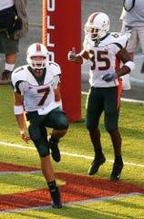 Brock Berlin (7) celebrates with teammate Ryan Moore after a first-quarter touchdown connection during a 2003 matchup against Louisiana Tech at Shreveport's Independence Stadium.