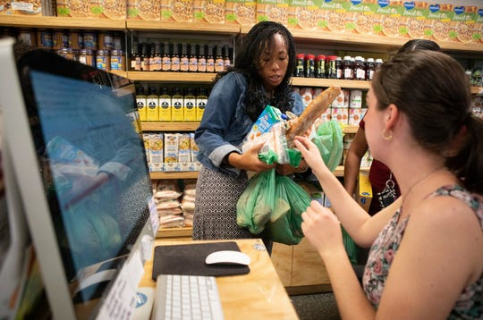 UC Berkeley junior Kiyoko Pitts checks out at the campus food pantry. Although all groceries are free, there are restrictions on certain items and each visitor must provide a campus ID card.