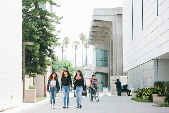 In July, incoming freshmen at San Jose State University walk through campus.
