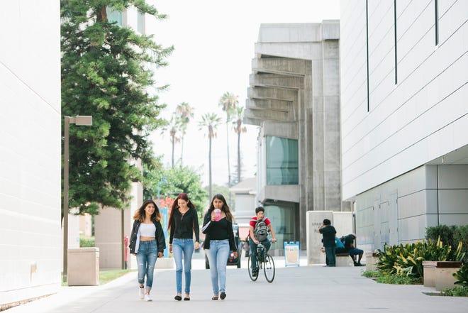 In July, incoming freshmen at San Jose State University walk through campus.