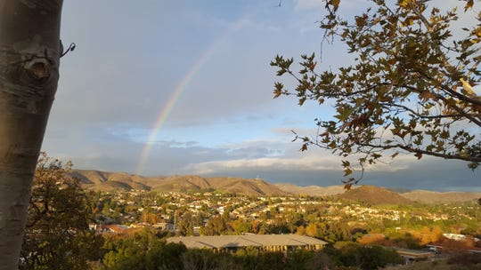 A rainbow appears Monday afternoon in Agoura Hills.