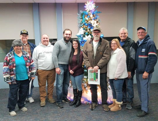The City of Vineland's 2019 David Di Giovacchino Holiday Lighting Contest winners are: (from left) Carol Trimnell, Buzz Trimnell, Kevin Steuer, Igor Zaharchuk, Jaclynn Marchisello, Gary Mazzone, Debi Mazzone, Mark Sockwell and Mac Sockwell.