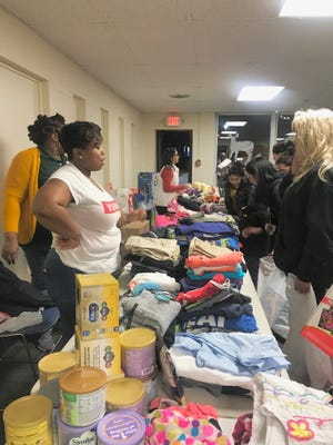 Girls Like You & Me, founded by Latresha Johnson, hosted a free community holiday outreach event at the Cumberland Cape Atlantic YMCA in Vineland to help families by providing clothing, food, toys and more on Dec. 20.