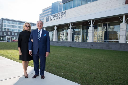 Jana and John F. Scarpa stand outside  Stockton University's academic building in Atlantic City on Monday. The building has been named after him following an $8 million from the family foundation.