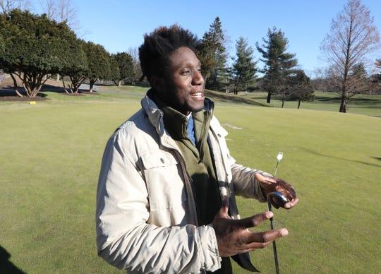 Osita Nduka of White Plains golfs at Maple Moor golf course in White Plains Dec. 24, 2019.