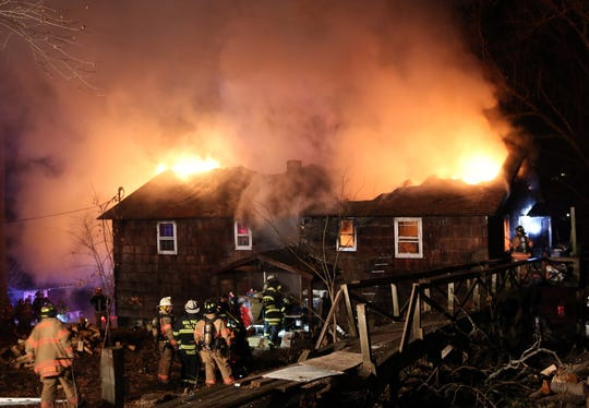 Mahopac Falls firefighters battle a fire that caused considerable damage to a house at 103 East Court in the Mahopac Falls section of Carmel Dec. 24, 2019. Firefighters from Mahopac, Somers and Mohegan assisted at the scene