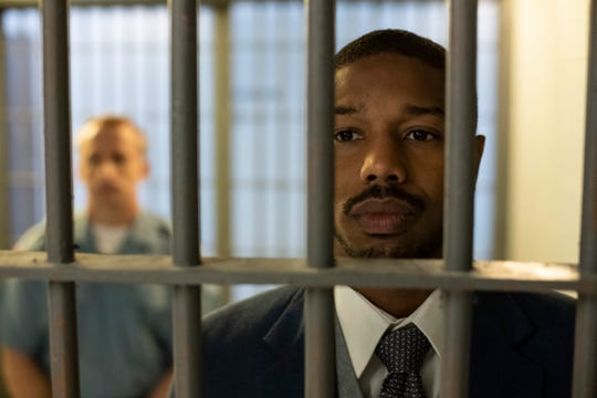 """This image released by Warner Bros Pictures shows Michael B. Jordan in a scene from """"Just Mercy."""" (Jake Netter/Warner Bros. Pictures via AP)"""