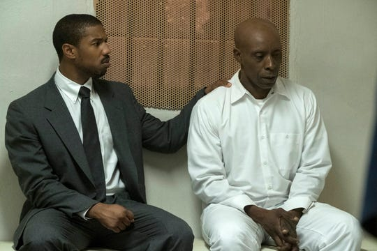 """This image released by Warner Bros Pictures shows Michael B. Jordan, left, and Rob Morgan in a scene from """"Just Mercy."""" (Jake Netter/Warner Bros. Pictures via AP)"""