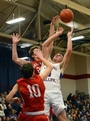 Carson Conley is fouled in the lane during the second half of Licking Valley's 72-50 loss to visiting Sheridan on Monday night in Hanover.