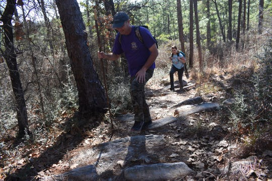 Jay Price (front) and Franny Young hike the Backbone Trail located in the Kisatchie National Forest near Natchitoches. The trail is popular with hikers who like the challenge it offers and diverse terrain including with sandstone formations and elevated views of the forest.