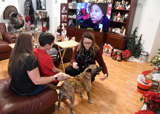 Briana Thomson plays with Cocoa at a Christmas party, Wednesday, Dec. 25, 2019. Thomson brings Cocoa around everywhere she goes while she's staying with her.