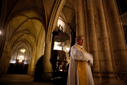Notre Dame cathedral rector Patrick Chauvet attends mass in Saint-Germain l'Auxerrois church in Paris on Tuesday.