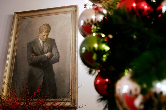 In this Nov. 30, 2006, file photo, a portrait of former President John F. Kennedy, framed by Christmas decorations, hangs in the White House in Washington.