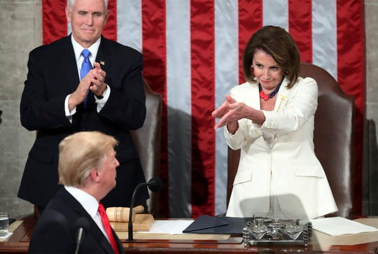 President Donald Trump turns to House Speaker Nancy Pelosi of Calif., as he delivers his State of the Union address to a joint session of Congress on Capitol Hill in Washington, as Vice President Mike Pence watches, on Feb. 5, 2019.