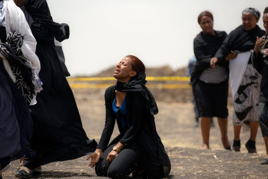 Relatives of crash victims mourn at the scene where the Ethiopian Airlines Boeing 737 Max 8 passenger jet crashed shortly after takeoff, killing all 157 on board, near Bishoftu, Ethiopia, south-east of Addis Ababa, on March 14, 2019.