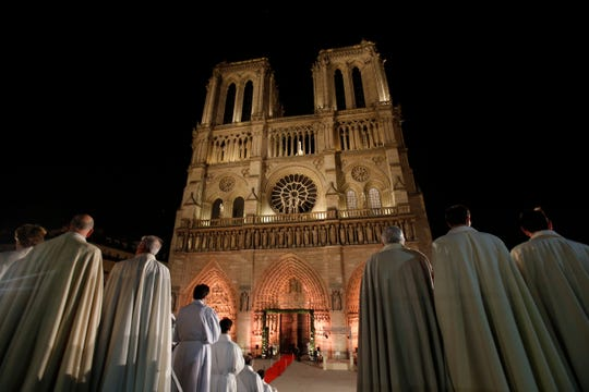 Religious dignitaries stand in front of Paris' Notre Dame Cathedral as part of a ceremony for its 850th anniversary, Wednesday, Dec. 12, 2012.