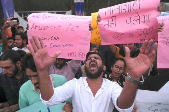 Indian Hyderabad Central University (HCU) students shout slogans during a protest rally against a new citizenship law in Hyderabad, India, Monday, Dec.16, 2019.
