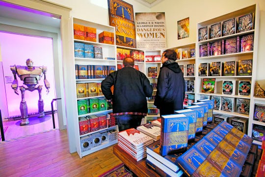 Robert Kelly and his son Dillon Kelly check out Beastly Books, George R R Martin's new book store in Santa Fe, N.M.