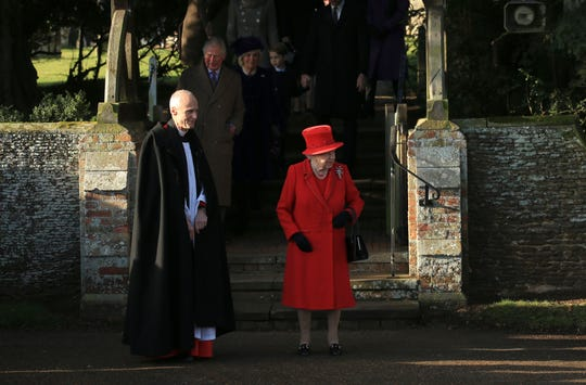 Britain's Queen Elizabeth II waits for her car after attending a Christmas day service at the St Mary Magdalene Church in Sandringham in Norfolk, England on Wednesday.