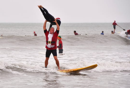 Bear and Cindy Woznick pulled off some tandem surfing Tuesday, Dec. 24, 2019.