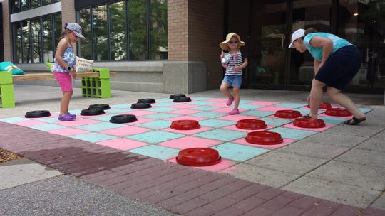 As part of the Building Active Communities Initiative, Get Fit volunteers transformed Davidson Plaza into a temporary active space which included a ping pong table, giant checkers, grass, plants and benches.