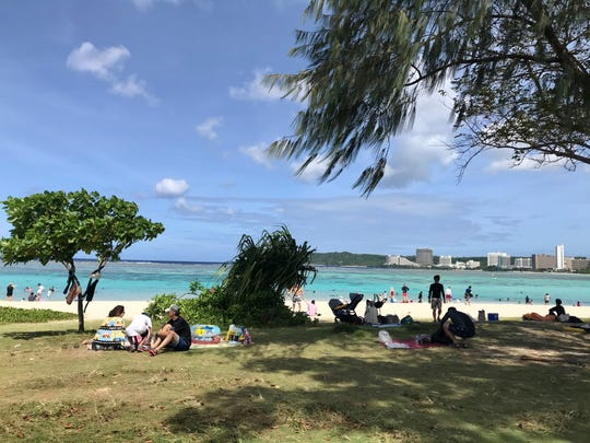 Residents, tourists and more enjoyed Christmas Day under the sun at Ypao Beach.
