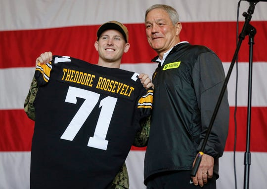 Iowa head football coach Kirk Ferentz poses for a photo with honorary captain and Navy second class petty officer Vincent O'Brien of Belle Plaine on Wednesday, Dec. 24, 2019, in Coronado, Calif. O'Brien is the only member of the 5,000 crew that is from Iowa.