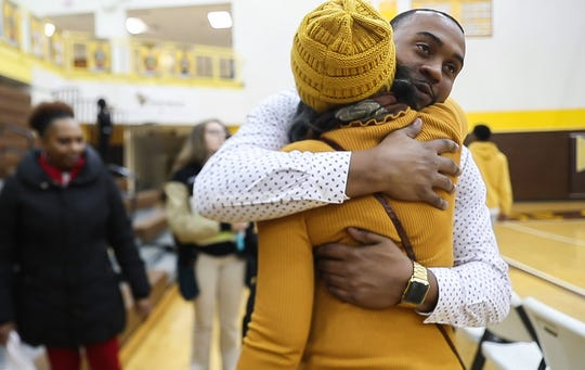Head coach of Howe basketball team, Deandre Brock hugs his grandmother Leora Jones after a game at Thomas Carr Howe High School, Indianapolis, Thursday, Dec.19, 2019. For the past ten years, Jones has traveled to every basketball game Brock has played and coached. In 155 games, Jones has been there in the stands keeping track of the score and cheering.