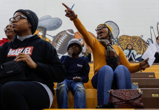 Leora Jones cheers next to her grand cousin Marquion Bonds while watching Deandre Brock coach a basketball game at Thomas Carr Howe High School, Indianapolis, Wednesday, Dec. 20, 2019. Jones has not missed one of her grandson's, Deandre Brock, basketball game in ten years.