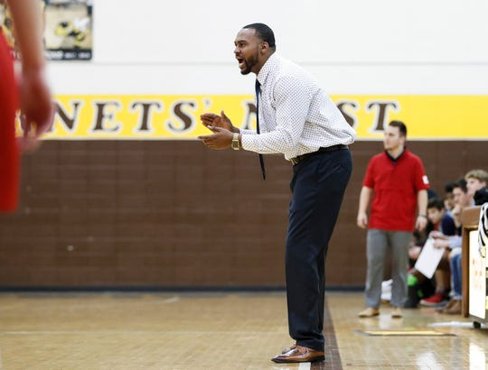 Head coach of Howe basketball team, Deandre Brock yells  to players from the sidelines during a game at Thomas Carr Howe High School, Indianapolis, Thursday, Dec. 19, 2019.