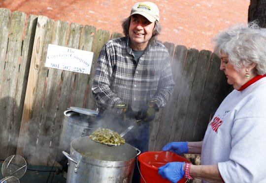 Carl Haisch and Norine Sloan help to prepare green beans for the hundreds of people gathered at Westy's, where they have been serving free holiday meals to those in need since 2003, on Christmas Day Wednesday, Dec. 25, 2019.
