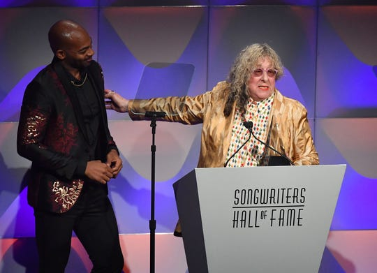 U.S. gospel singer Brandon Victor Dixon presents an award to Songwriters Hall of Fame Inductee Allee Willis on June 14, 2018, during the Songwriters Hall of Fame 49th Annual Induction and Awards Dinner in New York City.