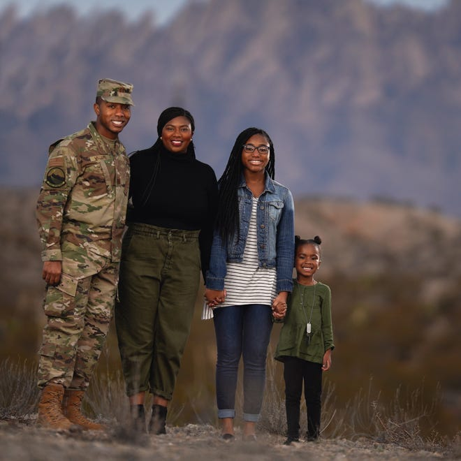 Space Operations Squadron Captain Julius Williams, left, his wife Ariel, and his daughters, Maya, 15, and Alaya, 4, pose for a photo Dec. 23, 2019, two days before Williams deployed to Afghanistan.