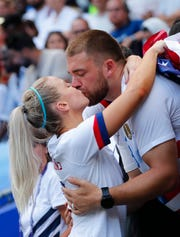 Julie Ertz, celebrating with her husband Zach Ertz after winning the Women's World Cup gold medal in July, is U.S. Soccer female Player of the Year. The Arizona native will be a Fiesta Bowl Parade grand marshal on Saturday.