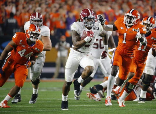 Alabama's Derrick Henry slips by the Clemson defense on his way to score a touchdown during the first quarter of the College Football Playoff National Championship game at the University of Phoenix Stadium in Glendale, Az., on Monday, January 11, 2016.