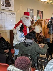 Christopher Herman (Santa) and the rest of run/walk participants sing carols with residents and staff on Christmas Day.