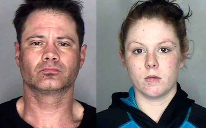 This undated booking photo provided by the Butte County Sheriff's Office shows Jeremy Blumlein, 41, of Chico, left, and Breanna Maier, 26, of Magalia. Deputies arrested them after they found 108 packages and envelopes addressed to approximately 56 people with 37 different addresses from Durham and Chico in their car after a short chase that ended with a rollover crash.
