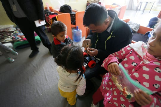 Ricardo Jimenez helps put together a toy for children at El Buen Samaritano Wednesday, Dec. 25, in Ciudad Juárez, Mexico. The gifts were provided by the State of Chihuahua's Population Council also known as COESPO.