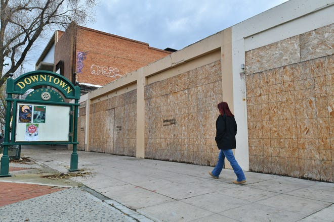 Plywood covers up a dirt lot on Main Street in Visalia. A fire destroyed the building that once stood at the site on Dec. 26, 2018. The land is now up for sale.