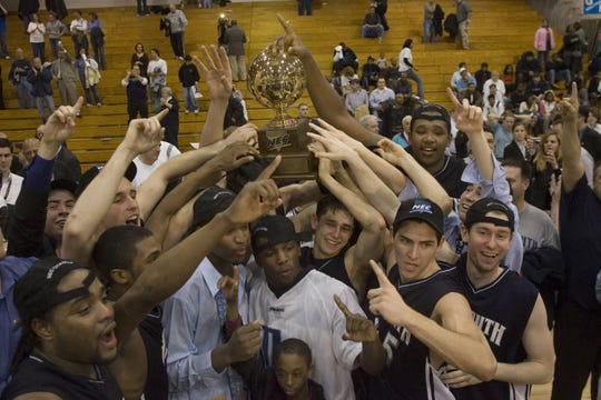 Monmouth players celebrate after winning the 2006 NEC Tournament at the Rothman Center in Hackensack.