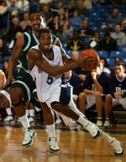 Monmouth's Whitney Coleman (5) drives past Wagner's Jamal Smith (20) in the second half of a 2008 game in West Long Branch.
