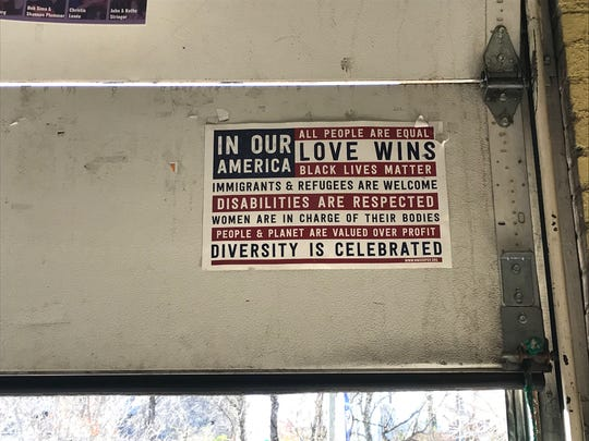 A sign promoting inclusion hangs inside Static Age Records.