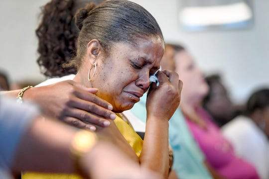 Keesha Martinez, mother of Candace Pickens, cries as Nathaniel Dixon is sentenced to life in prison at the Buncombe County Courthouse July 16, 2019 in Asheville, North Carolina.